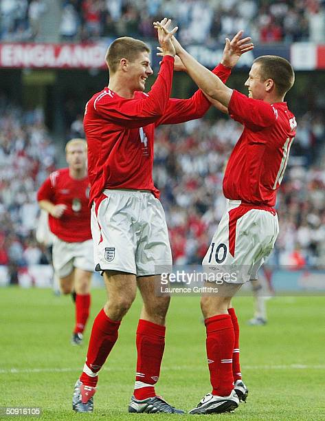 Michael Owen of England celebrates scoring the opening goal with team mate Steven Gerrard during the match between England and Japan held at the City...