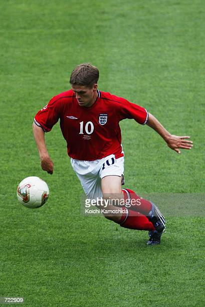 Michael Owen of England runs with the ball during the FIFA World Cup Finals 2002 Group F match between England and Nigeria played at the OsakaNagai...