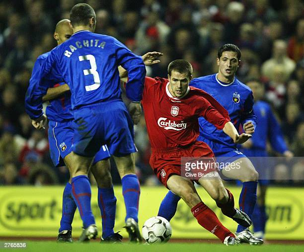 Michael Owen of Liverpool gets past Valeriu Rachita of Steaua during the UEFA Cup second round second leg match between liverpool and Steaua...