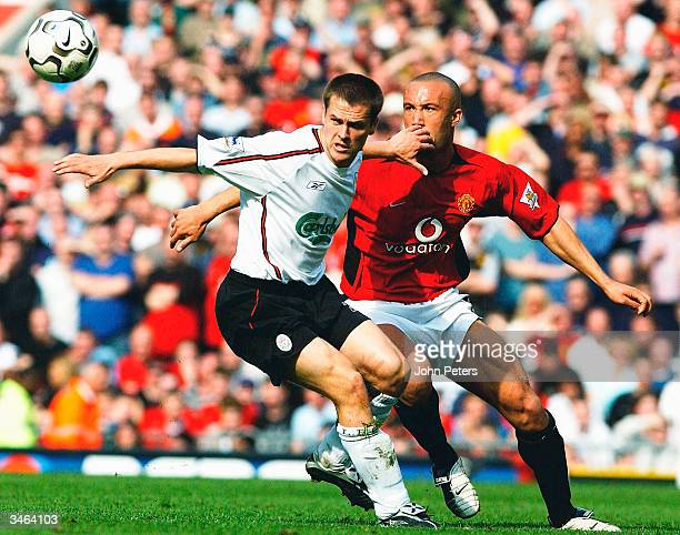 Michael Owen of Liverpool holds off Mikael Silvestre of Manchester United during the FA Barclaycard Premiership match between Manchester United and...