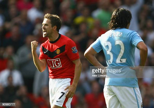 Michael Owen of Manchester United celebrates scoring the winning goal in injury time during the Barclays Premier League match between Manchester...