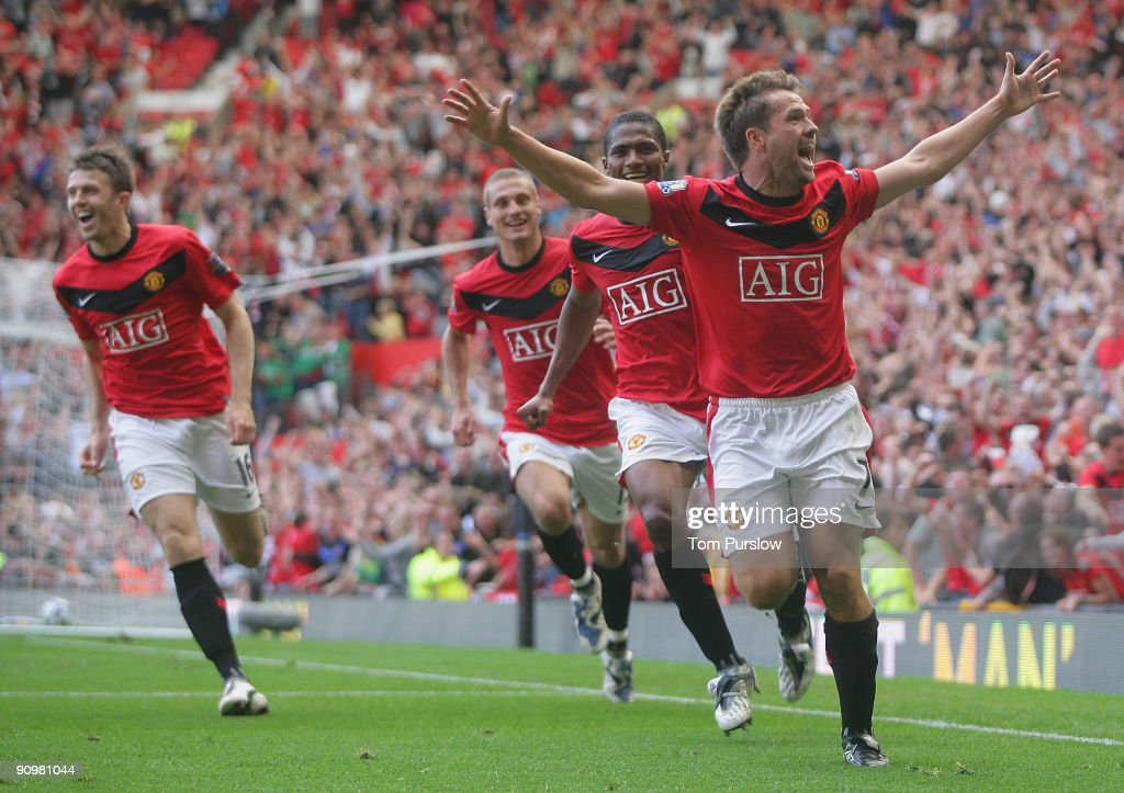 Michael Owen of Manchester United celebrates scoring their fourth goal during the Barclays Premier League match between Manchester United and Manchester City at Old Trafford on September 20 2009, in Manchester, England.