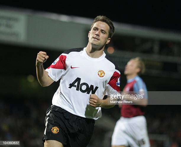 Michael Owen of Manchester United celebrates scoring their third goal during the Carling Cup Third Round match between Scunthorpe United and...