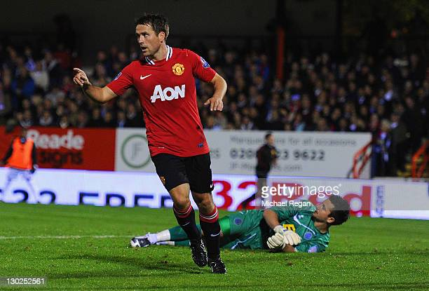 Michael Owen of Manchester United celebrates scoring to make it 20 during the Carling Cup fourth round match between Aldershot Town and Manchester...