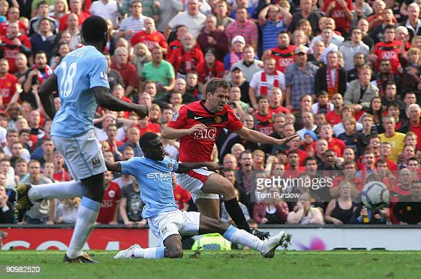 Michael Owen of Manchester United scores their fourth goal during the Barclays Premier League match between Manchester United and Manchester City at...