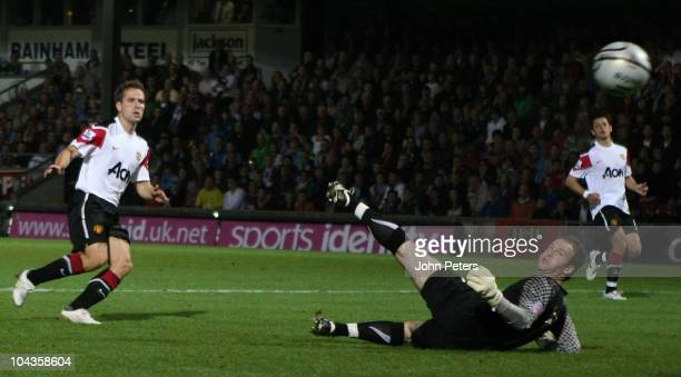Michael Owen of Manchester United scores their third goal during the Carling Cup Third Round match between Scunthorpe United and Manchester United at...