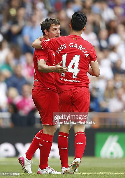 Michael Owen of Real Madrid Leyendas celebrates with Luis Garcia after scoring their team's second goal during the Corazon Classic charity match...