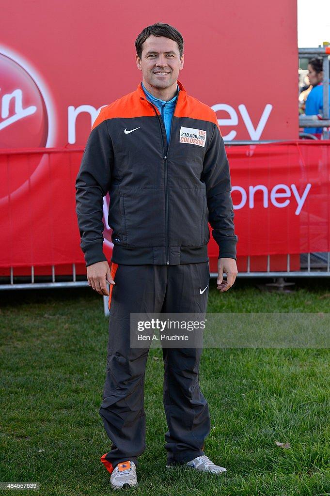 Michael Owen poses for photographs ahead of the Virgin Money London Marathon on April 13 2014 in London England