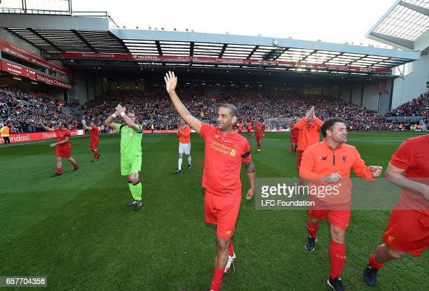 Michael Owen with Phil Babb Legends at the end of the LFC Foundation Charity Match between Liverpool Legends and Real Madrid Legends at Anfield on...