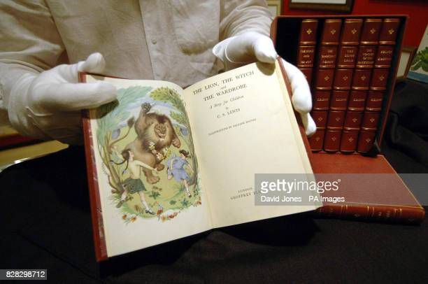 Michael P Emeny shows a bound set of first edition Narnia books by C S Lewis at the National Fine Arts and Antiques Fair Wednesday January 18 which...