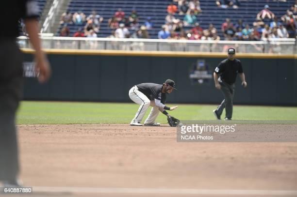 Michael Paez of Coastal Carolina University fields a grounder against the University of Arizona during Game 3 of the Division I Men's Baseball...