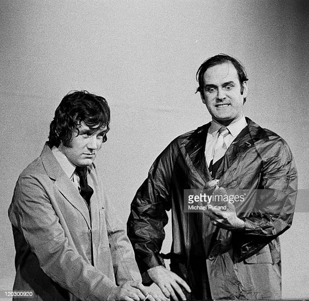 Michael Palin and John Cleese of comedy team Monty Python perform the 'Dead Parrot Sketch' on stage in London 1974