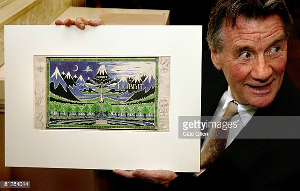 Michael Palin holds the original artwork for the cover of the Hobbit by JRR Tolkein on show at the Oxford University launch of a GBR 125 billion...