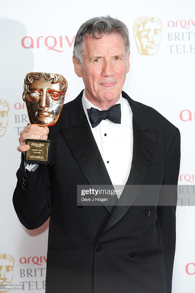 <a gi-track='captionPersonalityLinkClicked' href=/galleries/search?phrase=Michael+Palin&family=editorial&specificpeople=208240 ng-click='$event.stopPropagation()'>Michael Palin</a> poses with his Fellowship Award in front of the winners boards at the BAFTA TV Awards 2013 at The Royal Festival Hall on May 12, 2013 in London, England.