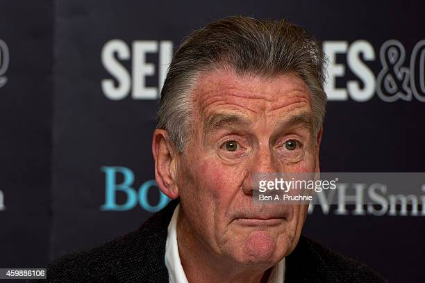 Michael Palin signs copies of his book 'Travelling To Work' at Selfridges on December 3 2014 in London England