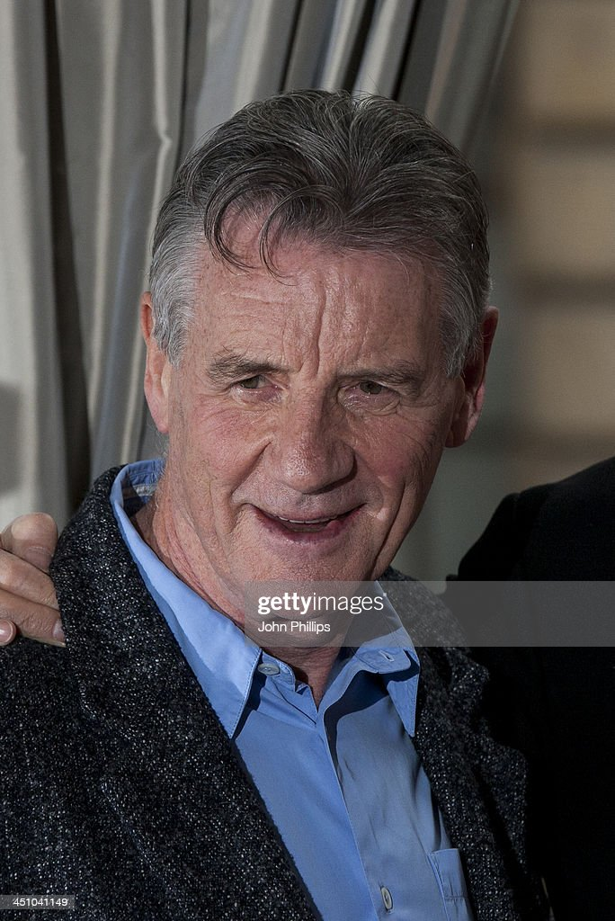 Michael Palin urin a photograph ahead of a press conference in central London on November 21, 2013 in London, England.