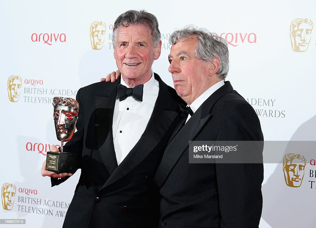 Michael Palin with his Fellowship Award and presenter Terry Jones during the Arqiva British Academy Television Awards 2013 at the Royal Festival Hall on May 12, 2013 in London, England.