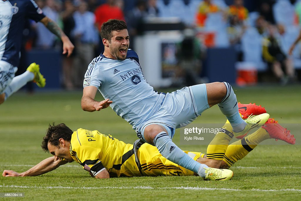 <a gi-track='captionPersonalityLinkClicked' href=/galleries/search?phrase=Michael+Parkhurst&family=editorial&specificpeople=553653 ng-click='$event.stopPropagation()'>Michael Parkhurst</a> #4 of Columbus Crew takes down Hassan Ali 'Soony' Saad #22 of Sporting KC May 4, 2014 at Sporting Park in Kansas City, Kansas.