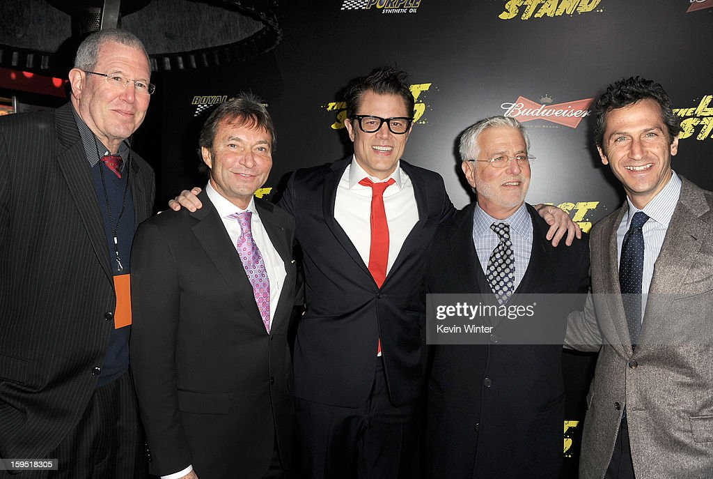 Michael Paseornek, Lionsgate Motion Picture Group President of Motion Picture Production and Development, Patrick Wachsberger, Lionsgate Motion Picture Group Co-Chairman, actor Johnny Knoxville, Rob Friedman, Lionsgate Motion Picture Group Co-Chairman, and Erik Feig, Lionsgate Motion Picture Group President of Production arrive at the premiere of Lionsgate Films' 'The Last Stand' at Grauman's Chinese Theatre on January 14, 2013 in Hollywood, California.