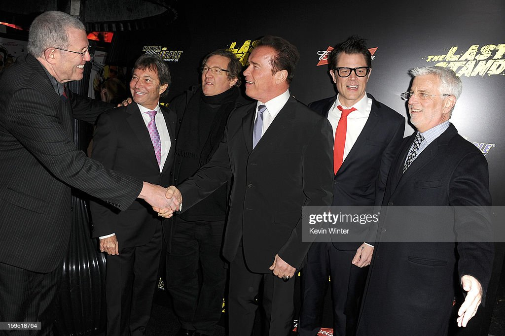 Michael Paseornek, Lionsgate Motion Picture Group President of Motion Picture Production and Development, Patrick Wachsberger, Lionsgate Motion Picture Group Co-Chairman, producer Lorenzo di Bonaventura, actors Arnold Schwarzenegger, Johnny Knoxville, and Rob Friedman, Lionsgate Motion Picture Group Co-Chairman arrive at the premiere of Lionsgate Films' 'The Last Stand' at Grauman's Chinese Theatre on January 14, 2013 in Hollywood, California.