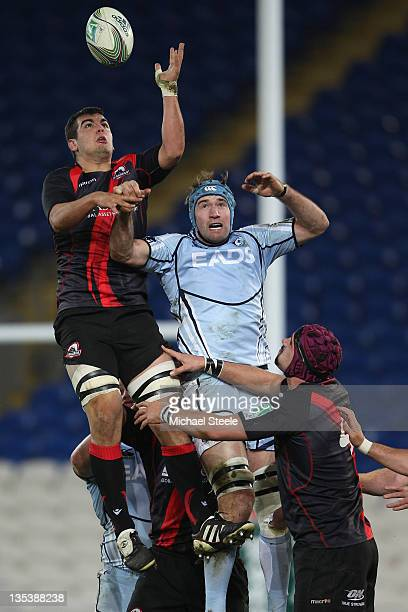 Michael Paterson of Cardiff loses out to Stuart McInally of Edinburgh in a line out during the Heineken Cup Pool Two match between Cardiff Blues and...