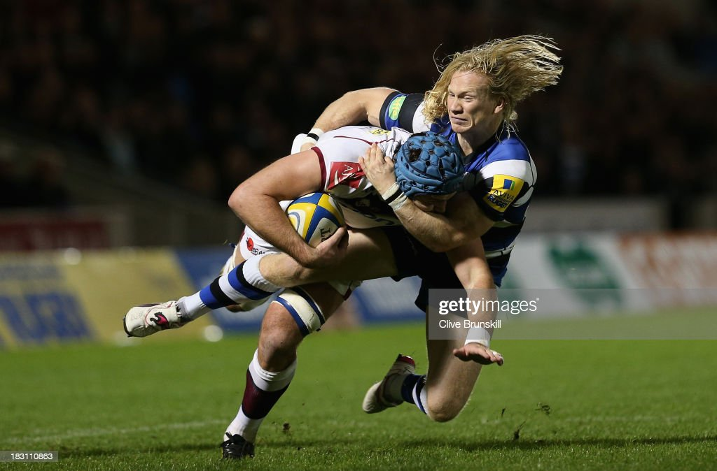 Michael Paterson of Sale is tackled by Tom Biggs of Bath during the Aviva Premiership match between Sale Sharks and Bath at the AJ Bell Stadium on October 4, 2013 in Salford, England.