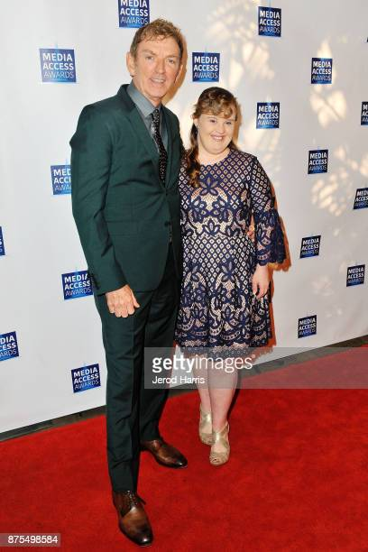 Michael Patrick King and Jamie Brewer attend the Media Access Awards 2017 at The Four Seasons on November 17 2017 in Beverly Hills California