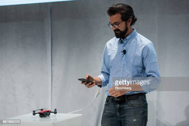 Michael Perry director of strategic partnerships at SZ DJI Technology Co uses a smartphone to edit footage from the Spark gesture controlled drone...
