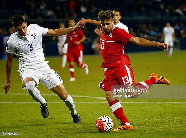Michael Petrasso of Canada and Matt Miazga of the USA compete for the ball during the 2015 CONCACAF Olympic Qualifying match at Sporting Park on...