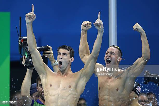 Michael Phelps and Caeleb Dressel of the United States celebrate winning gold in the Final of the Men's 4 x 100m Freestyle Relay on Day 2 of the Rio...