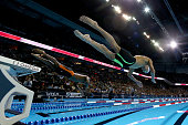 Michael Phelps and Giles Smith of the United States dive in to compete in the final heat for the Men's 100 Meter Butterfly during Day Seven of the...