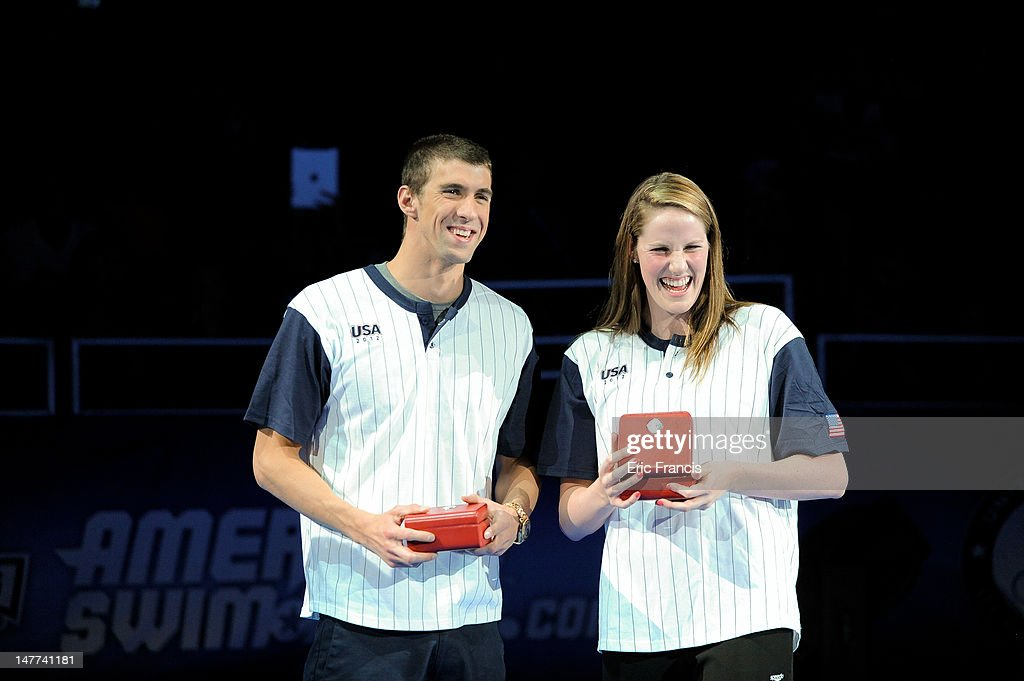 <a gi-track='captionPersonalityLinkClicked' href=/galleries/search?phrase=Michael+Phelps&family=editorial&specificpeople=162698 ng-click='$event.stopPropagation()'>Michael Phelps</a> and <a gi-track='captionPersonalityLinkClicked' href=/galleries/search?phrase=Missy+Franklin+-+Swimmer&family=editorial&specificpeople=6623958 ng-click='$event.stopPropagation()'>Missy Franklin</a> react after receiving their Omega watches for Male and Female swimmer of the meet after day eight of the 2012 U.S. Olympic Swimming Team Trials at the CenturyLink Center July 2, 2012 in Omaha, Nebraska.