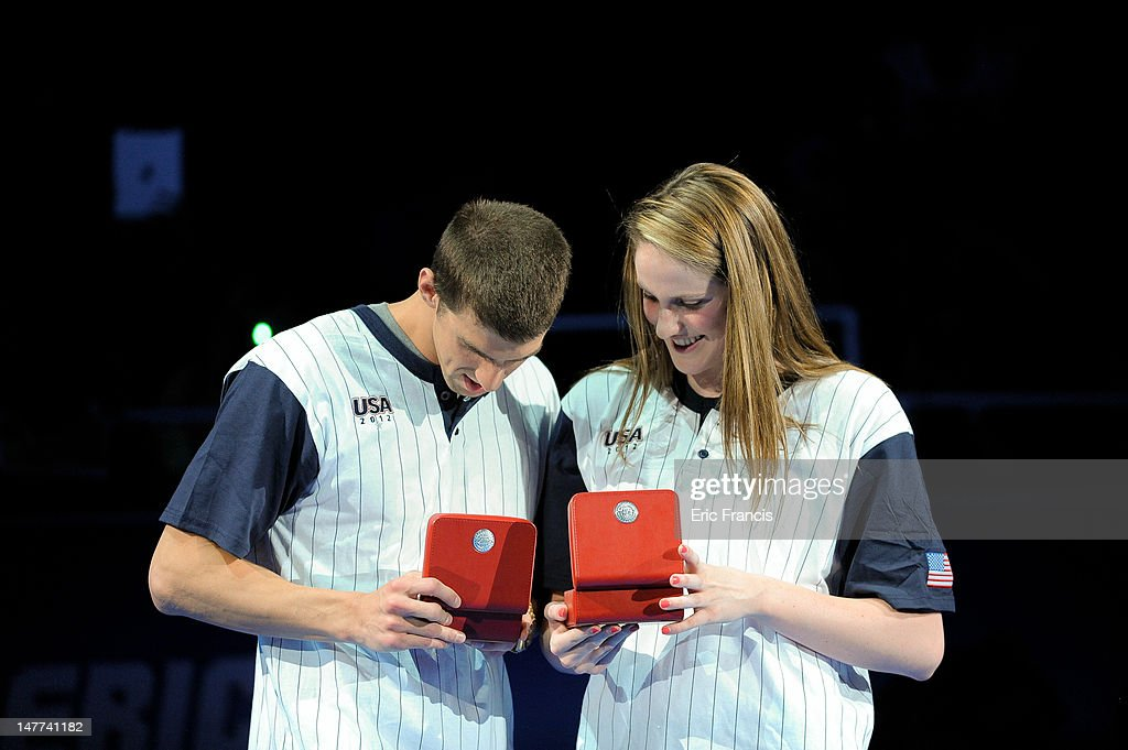 Michael Phelps and Missy Franklin react after receiving their Omega watches for Male and Female swimmer of the meet after day eight of the 2012 U.S. Olympic Swimming Team Trials at the CenturyLink Center July 2, 2012 in Omaha, Nebraska.