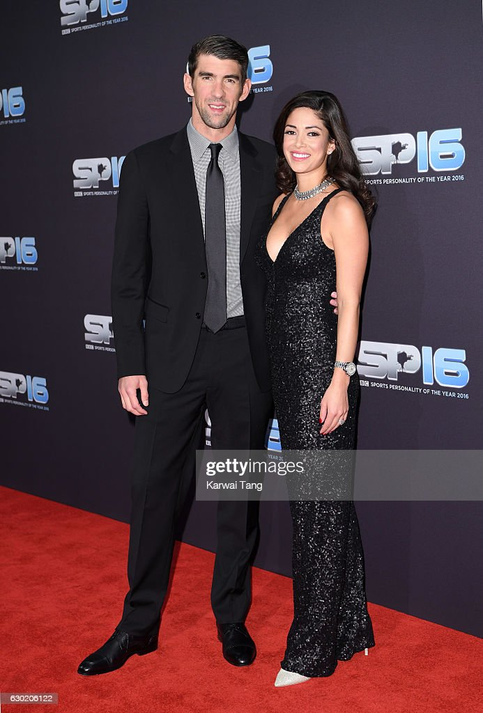 Michael Phelps and Nicole Johnson attend the BBC Sports Personality Of The Year at Resorts World on December 18, 2016 in Birmingham, United Kingdom.