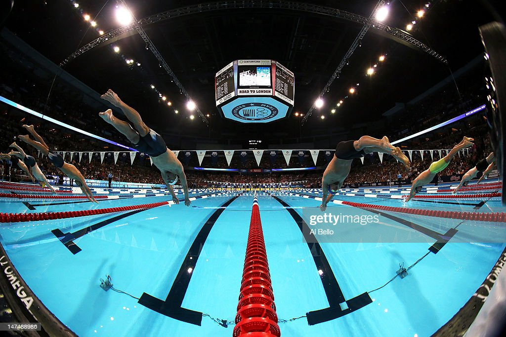 <a gi-track='captionPersonalityLinkClicked' href=/galleries/search?phrase=Michael+Phelps&family=editorial&specificpeople=162698 ng-click='$event.stopPropagation()'>Michael Phelps</a> (left of center lane) and <a gi-track='captionPersonalityLinkClicked' href=/galleries/search?phrase=Ryan+Lochte&family=editorial&specificpeople=182557 ng-click='$event.stopPropagation()'>Ryan Lochte</a> (right of center lane) dive of the starting block at the start of the championship final of the Men's 200 m Individual Medley during Day Six of the 2012 U.S. Olympic Swimming Team Trials at CenturyLink Center on June 30, 2012 in Omaha, Nebraska.