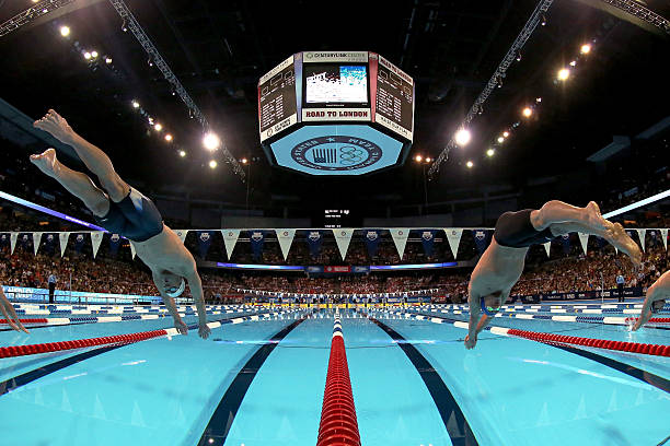 michael phelps and ryan lochte dive of the starting block at the start of the championship