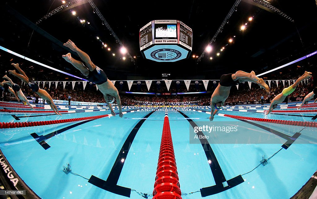 Michael Phelps and Ryan Lochte dive of the starting block at the start of the championship final of the Men's 200 m Individual Medley during Day Six of the 2012 U.S. Olympic Swimming Team Trials at CenturyLink Center on June 30, 2012 in Omaha, Nebraska.