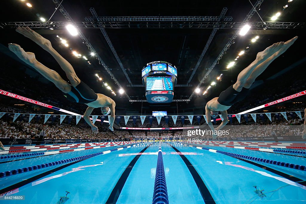 Michael Phelps and Ryan Lochte of the United States dive in to compete in the final heat for the Men's 200 Meter Individual Medley during Day Six of...