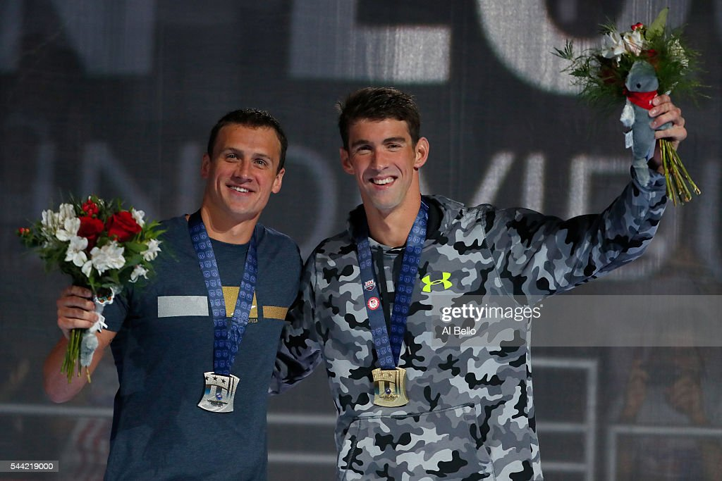 Michael Phelps and Ryan Lochte of the United States participate in the medal ceremony for the Men's 200 Meter Individual Medley during Day Six of the...