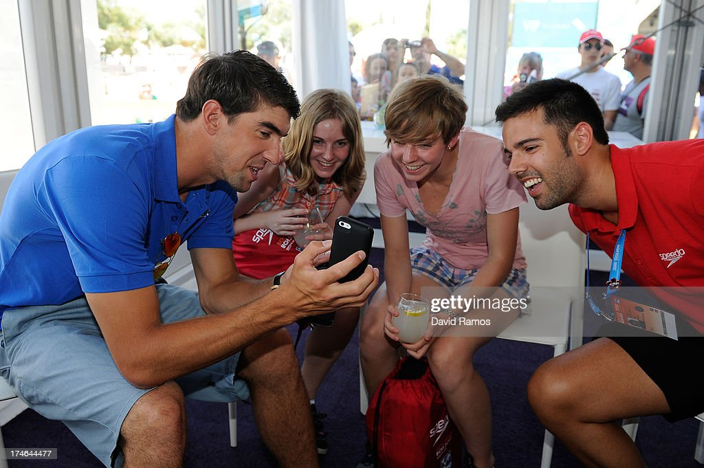 <a gi-track='captionPersonalityLinkClicked' href=/galleries/search?phrase=Michael+Phelps&family=editorial&specificpeople=162698 ng-click='$event.stopPropagation()'>Michael Phelps</a> chat with the winner competition (C) during their visit to the Speedo Store during the Barcelona 2013 World Swimming Championships on July 28, 2013 in Barcelona, Spain.