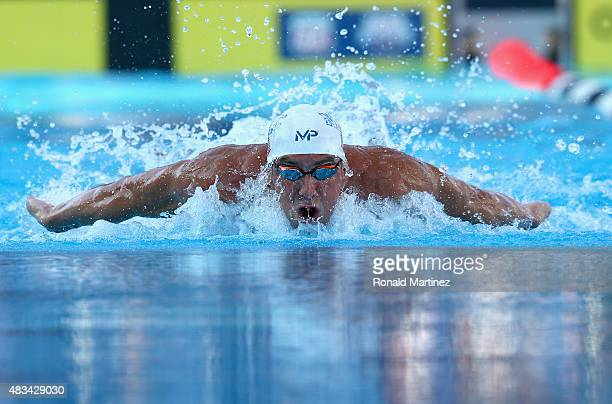 Michael Phelps competes in the Mens 100 LC Meter Butterfly final during the 2015 Phillips 66 National Championships at the Northside Swim Center on...