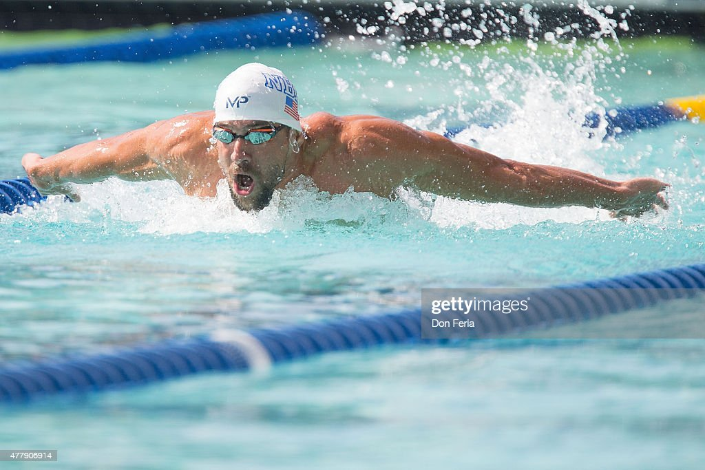 Michael Phelps competes in the men's 200 meter butterfly on day three of the 2015 Arena Pro Swim Series at the George F Haines International Swim...