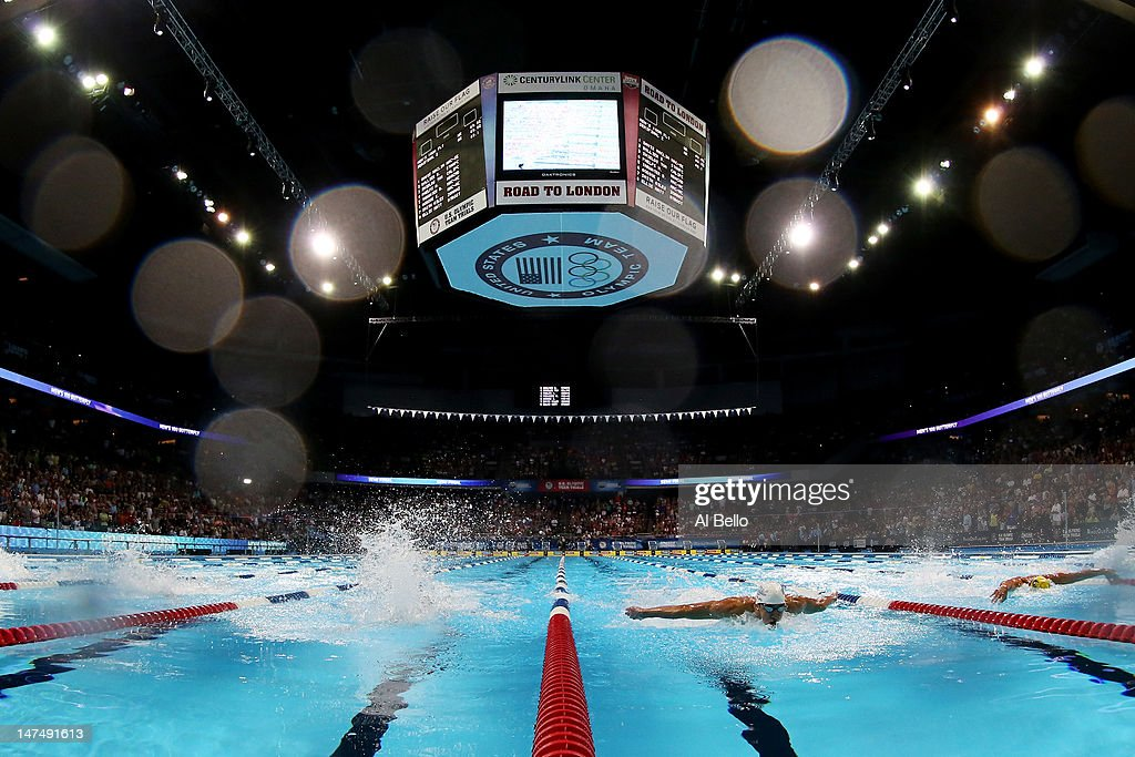 Michael Phelps competes in the second semifinal heat of the Men's 100 m Butterflyduring Day Six of the 2012 US Olympic Swimming Team Trials at...