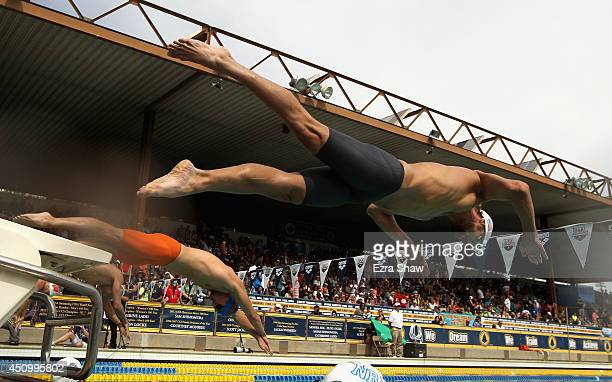 Michael Phelps dives in for the start of the men's 200 meter freestyle during the 2014 Arena Grand Prix of Santa Clara at the George F Haines...