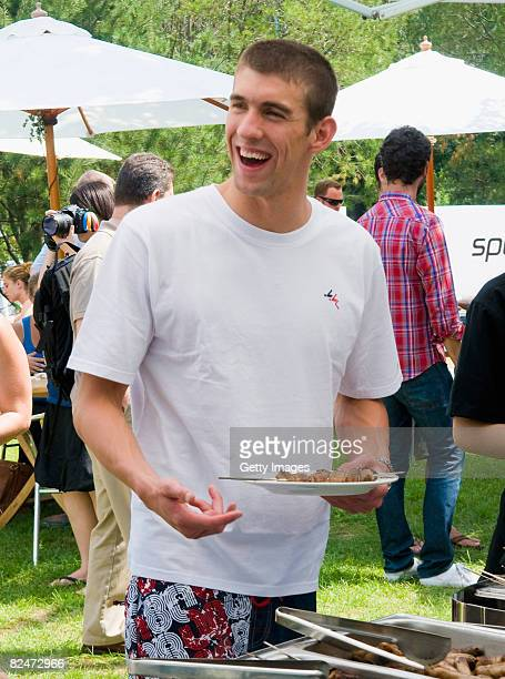 Michael Phelps enjoys the buffet at the Speedo Sports Club at the Jintai Art Museum on August 19 2008 in Beijing China