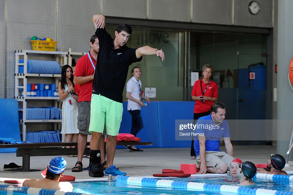 Michael Phelps gives instructions to journalist during a Speedo Clinic at Holmes Palace on July 29, 2013 in Barcelona, Spain.