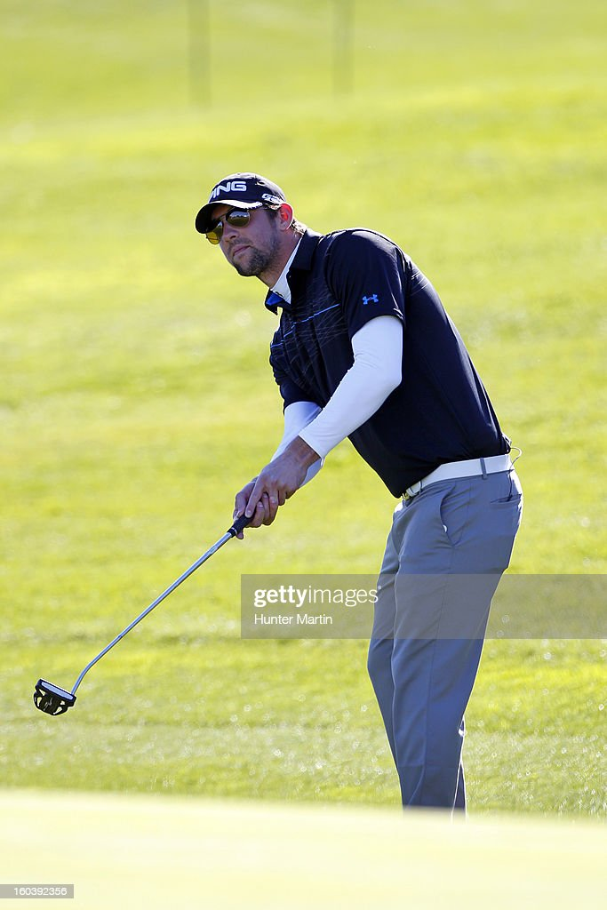 <a gi-track='captionPersonalityLinkClicked' href=/galleries/search?phrase=Michael+Phelps&family=editorial&specificpeople=162698 ng-click='$event.stopPropagation()'>Michael Phelps</a> hits his third shot on the 18th hole during the Wednesday Pro-Am of the Waste Management Phoenix Open at TPC Scottsdale on January 30, 2013 in Scottsdale, Arizona.