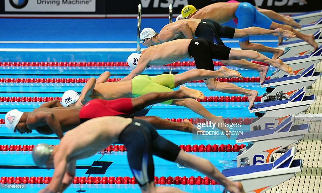Michael Phelps In Lane 4 And Fellow Competitors Jup From Their Starting  Blocks To Start The