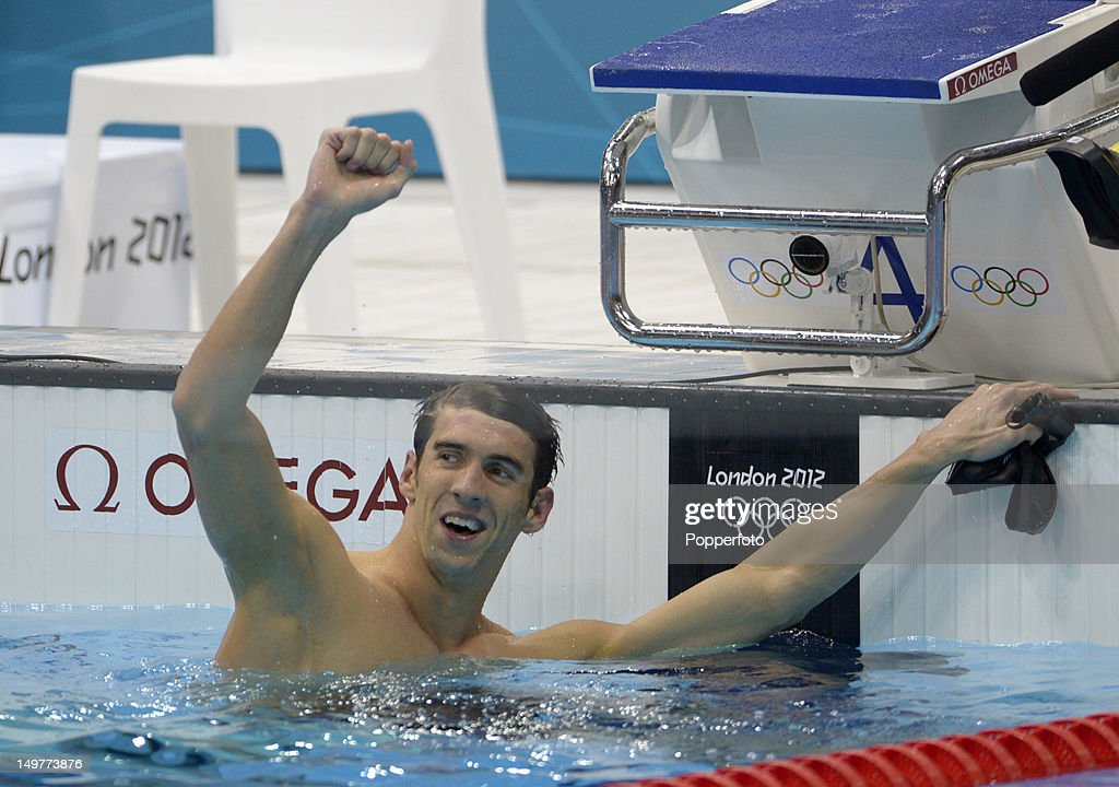 Michael Phelps of the United States celebrates winning the MenÕs 100m Butterfly Final on Day 7 of the London 2012 Olympic Games at the Aquatics Centre on August 3, 2012 in London, England.
