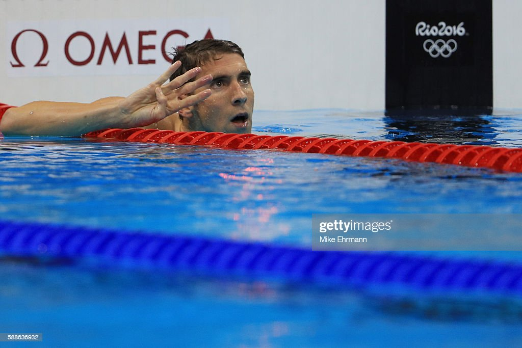 Michael Phelps of the United States celebrates winning the Men's 200m Individual Medley Final on Day 6 of the Rio 2016 Olympic Games at the Olympic...